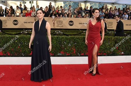 Shannon Woodward, left, and Sidse Babett Knudsen arrive at the 23rd annual Screen Actors Guild Awards at the Shrine Auditorium & Expo Hall, in Los Angeles