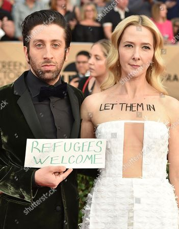 Simon Helberg, left, and Jocelyn Towne arrive at the 23rd annual Screen Actors Guild Awards at the Shrine Auditorium & Expo Hall, in Los Angeles