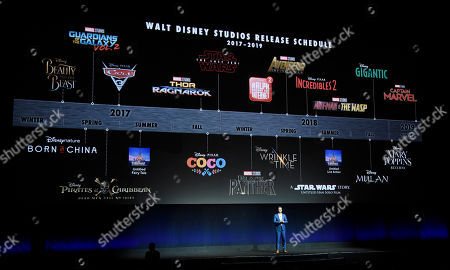 Dave Hollis, executive vice president of theatrical exhibition sales and distribution for Walt Disney Studios, speaks underneath a timeline of Walt Disney Studios' upcoming film releases during their presentation at CinemaCon 2017 at Caesars Palace, in Las Vegas