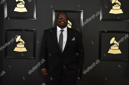 Jason Boyd, aka Poo Bear, arrives at the 59th annual Grammy Awards at the Staples Center, in Los Angeles