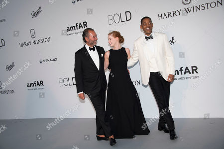 Remo Ruffini, Jessica Chastain and Will Smith pose for photographers upon arrival at the amfAR charity gala during the Cannes 70th international film festival, Cap d'Antibes, southern France
