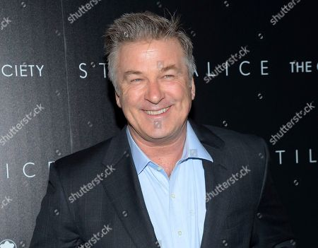 """Stock Picture of Actor Alec Baldwin attends a special screening of his film """"Still Alice"""" in New York. Baldwin is teaming with author Kurt Andersen on the satirical book â?oeYou Canâ?™t Spell America Without Me: The Really Tremendous Inside Story of My Fantastic First Year as President Donald J. Trump,â?? Penguin Press announced . The book is scheduled to come out Nov. 7"""
