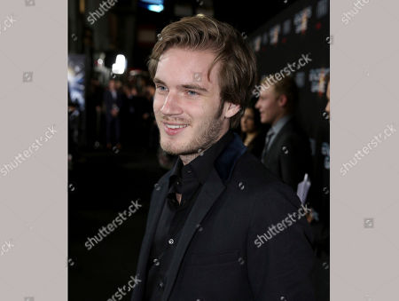 """YouTube star Felix Kjellberg arrives at the premiere of """"Ender's Game"""" in Los Angeles. Disney's Maker Studios and Googleâ?™s YouTube are distancing themselves from Kjellberg after he made jokes about anti-Semitism and posted Nazi imagery in his videos. Kjellberg, a Swedish YouTube star known as PewDiePie, with more than 53 million subscribers, rose to fame by posting gaming videos"""