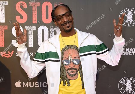 "Stock Picture of Snoop Dogg arrives at the Los Angeles premiere of ""Can't Stop, Won't Stop: A Bad Boy Story"" at the Writers Guild Theater on in Beverly Hills, Calif. Snoop Dogg, Shonda Rhimes, ""Weird Al"" Yankovic and late entertainers Bernie Mac and Steve Irwin will be receiving stars on Hollywood's Walk of Fame next year. The Hollywood Chamber of Commerce revealed the 2018 honorees Thursday"
