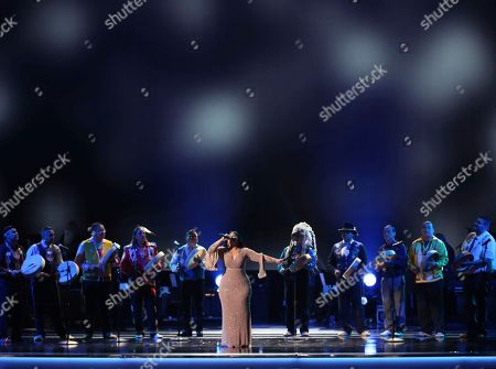 Mexican singer Carla Morrison, center, and Northern Cree perform at the 59th annual Grammy Awards, in Los Angeles