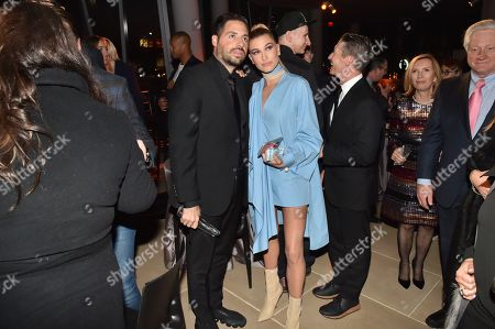 Stock Photo of Ronnie Fieg and Hailey Baldwin attend the Footwear News Achievement Awards at the IAC on November 28, 2017 in New York
