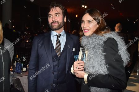 Michael Atmore and Alexa Chung attends the Footwear News Achievement Awards at the IAC on November 28, 2017 in New York