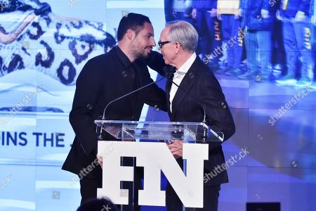 Ronnie Fieg and Tommy Hilfiger attends the Footwear News Achievement Awards at the IAC on November 28, 2017 in New York