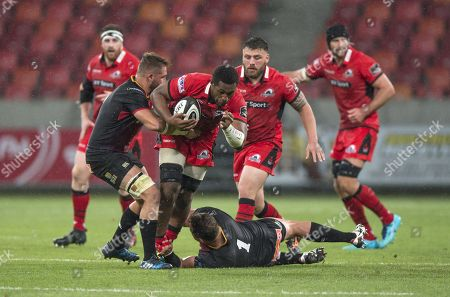 Viliame Mata of Edinburgh is tackled by Schalk Ferreira - captain of the Southern Kings
