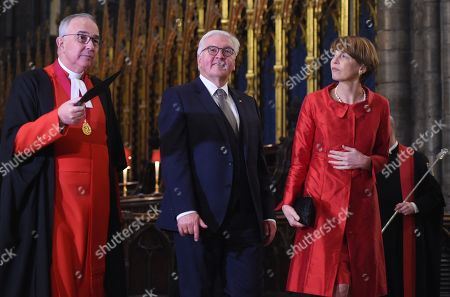 Germany's President Frank-Walter Steinmeier (2-L) and his wife Elke Budenbender (C) stand with The Very Reverend Dr John Hall (R), Dean of Westminster Abbey during a visit to Westminster Abbey in London, Britain 28 November 2017. Frank-Walter Steinmeier and his wife are on a one day official visit to London.
