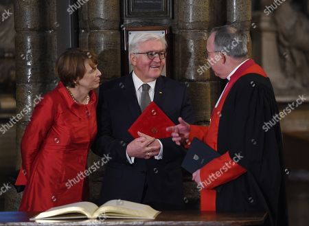 Germany's President Frank-Walter Steinmeier (R) and his wife Elke Budenbender (C) stand with The Very Reverend Dr John Hall (R), Dean of Westminster Abbey after signing a visitor's book next the grave of the Unknown Warrior during a visit to the Anglican Westminster Abbey in London, Britain 28 November 2017. Frank-Walter Steinmeier and his wife are on a one day official visit to London.