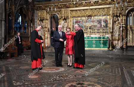 Germany's President Frank-Walter Steinmeier (2-L) and his wife Elke Budenbender (C) stand with The Very Reverend Dr John Hall (R), Dean of Westminster Abbey during a visit to the Anglican Westminster Abbey in London, Britain 28 November 2017. Frank-Walter Steinmeier and his wife are on a one day official visit to London.