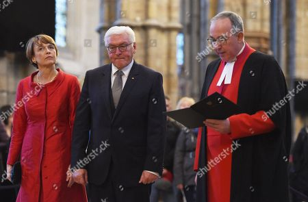 Germany's President Frank-Walter Steinmeier (C) and his wife Elke Budenbender (L) stand with The Very Reverend Dr John Hall (R), Dean of Westminster Abbey during a visit to the Anglican Westminster Abbey in London, Britain 28 November 2017. Frank-Walter Steinmeier and his wife are on a one day official visit to London.