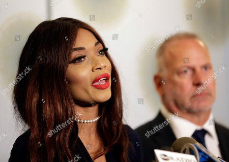 Kadian Noble speaks during a news conference as her attorney Jeff Herman looks on in New York, . On Monday, Noble filed a lawsuit against the disgraced movie producer under a federal sex-trafficking statute. She alleges that Weinstein sexually assaulted her in 2014 during the Cannes Film Festival