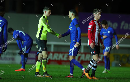 James Hamon of Exeter City shakes hands with Isaac Christie-Davies of Chelsea during the Checktrade Trophy match between Exeter City and Chelsea u23 at St James Park on November 28th , Exeter, Devon.
