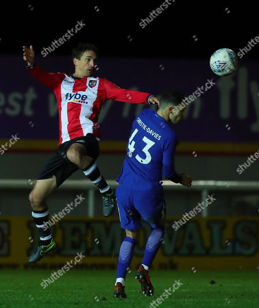 Craig Woodman of Exeter City challenges for the aerial ball with Isaac Christie-Davies of Chelsea during the Checktrade Trophy match between Exeter City and Chelsea u23 at St James Park on November 28th , Exeter, Devon.