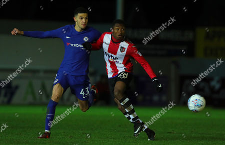 Kyle Edwards of Exeter City holds off Isaac Christie-Davies of Chelsea during the Checktrade Trophy match between Exeter City and Chelsea u23 at St James Park on November 28th , Exeter, Devon.