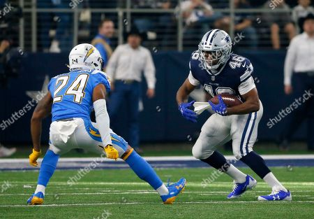 Alfred Morris, Trevor Williams. Los Angeles Chargers cornerback Trevor Williams (24) defends as Dallas Cowboys running back Alfred Morris (46) runs the ball during an NFL football game, in Arlington, Texas