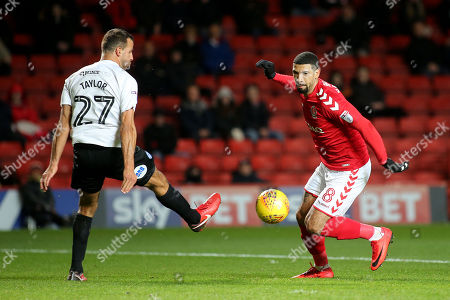 Leon Best of Charlton Athletic takes the ball past Peterborough's Steven Taylor during Charlton Athletic vs Peterborough United, Sky Bet EFL League 1 Football at The Valley on 28th November 2017