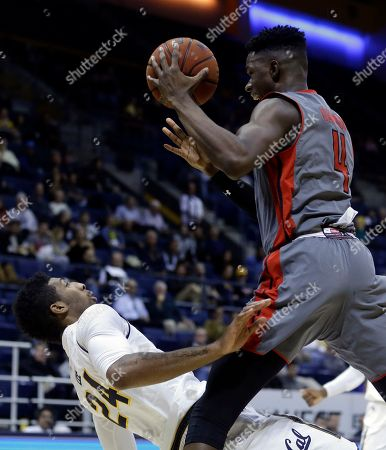 Tavrion Dawson, Marcus Lee. Cal State Northridge forward Tavrion Dawson, right, collides with California's Marcus Lee (24) during the second half of an NCAA college basketball game, in Berkeley, Calif