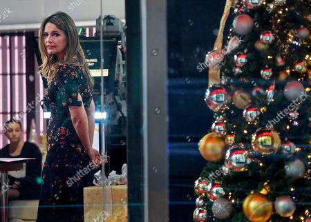 """Today"""" show host Savannah Guthrie looks out the window while on the set of the show, in New York, after NBC News fired host Matt Lauer. NBC News announced Wednesday, Nov. 29, 2017, that Lauer was fired for """"inappropriate sexual behavior"""