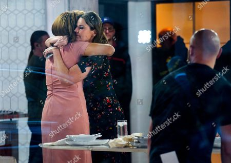 """Co-anchors Hoda Kotb, left, and Savannah Guthrie embrace on the set of the """"Today"""" show, in New York, after NBC News fired host Matt Lauer. NBC News announced Wednesday, Nov. 29, 2017, that Lauer was fired for """"inappropriate sexual behavior"""