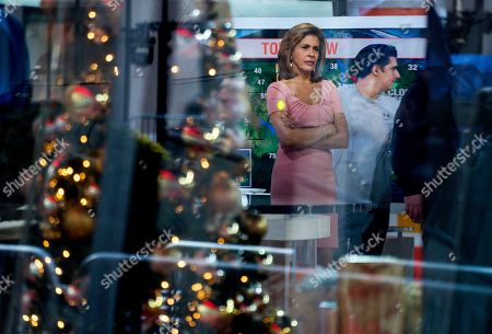"""Anchor Hoda Kotb stands on the set of the """"Today"""" show between segments, in New York, after NBC News fired host Matt Lauer. NBC News announced Wednesday, Nov. 29, 2017, that Lauer was fired for """"inappropriate sexual behavior"""