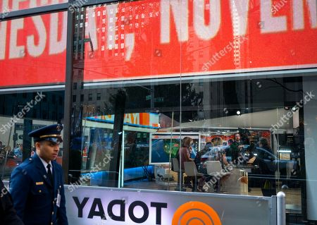 """A person passes by the set of the """"Today"""" show during their broadcast, in New York. NBC News says longtime """"Today"""" show host Matt Lauer has been fired for """"inappropriate sexual behavior."""" Co-host Savannah Guthrie made the announcement at the top of Wednesday's show"""