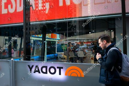 """A person passes by the set of Today Show during the broadcast, in New York. NBC News says longtime """"Today"""" show host Matt Lauer has been fired for """"inappropriate sexual behavior."""" Co-host Savannah Guthrie made the announcement at the top of Wednesday's show"""