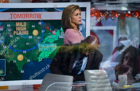 """Anchor Hoda Kotb, with co-anchor Al Roker, lower center, stands on the set of the """"Today"""" show between segments, in New York, after NBC News fired host Matt Lauer. NBC News announced Wednesday, Nov. 29, 2017, that Lauer was fired for """"inappropriate sexual behavior"""