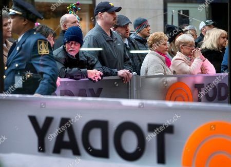"""People stand outside the set of """"Today"""" show, in New York, after NBC News fired host Matt Lauer. NBC News announced Wednesday, Nov. 29, 2017, that Lauer was fired for """"inappropriate sexual behavior"""