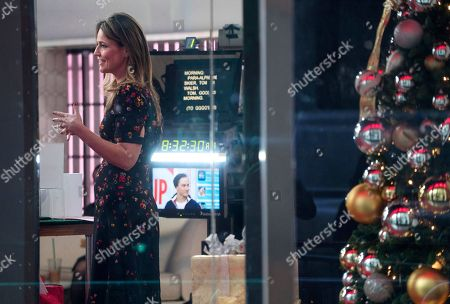 """Anchor Savannah Guthrie stands near a window while on the set of the """"Today"""" show, in New York, after NBC News fired host Matt Lauer. NBC News announced Wednesday, Nov. 29, 2017, that Lauer was fired for """"inappropriate sexual behavior"""