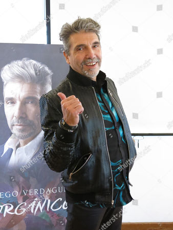 """Stock Image of The Argentine-born singer Diego Verdaguer strikes a pose during an interview in Mexico City. Verdaguer includes banda, electronic music, and pop in his latest album """"Organico"""