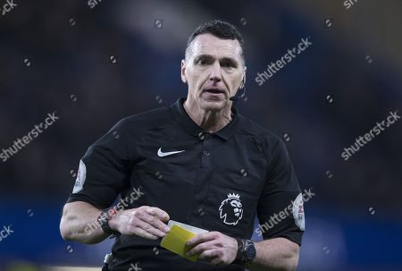 Referee Neil Swarbrick with Yellow Card