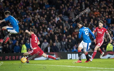 Carlos Pena of Rangers shoots past Anthony O'Connor of Aberdeen to give them a 2-0 lead