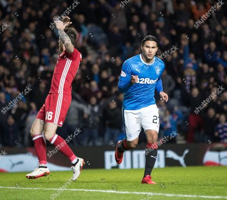 Carlos Pena of Rangers celebrates scoring to  to give them a 2-0 lead with a dejected Greg Tansey of Aberdeen in the background
