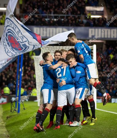 Carlos Pena of Rangers is mobbed by team mates as he celebrates scoring to give them a 2-0 lead
