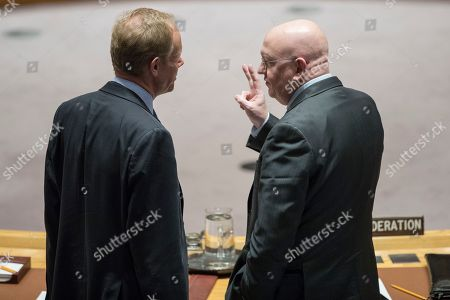Vassily Nebenzia, Matthew Rycroft. British Ambassador to the United Nations Matthew Rycroft, left, speaks to Russian Ambassador Vassily Nebenzia before a Security Council meeting on the situation in North Korea, at United Nations headquarters