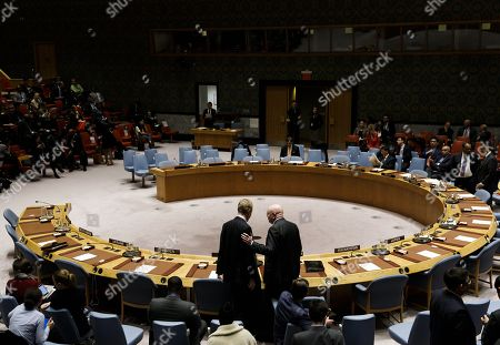 Matthew Rycroft (L), the United Kingdom's Ambassador to the United Nations, talks with Vassily Nebenzea, Russia's Ambassador to the United Nations, at the start of an emergency United Nations Security Council meeting in response to an intercontinental ballistic missile test by North Korea, at United Nations headquarters in New York, New York, USA, 29 November 2017.