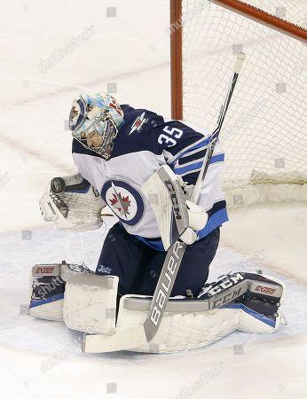 Winnipeg Jets goalie Steve Mason (35) against the San Jose Sharks during an NHL hockey game in San Jose, Calif