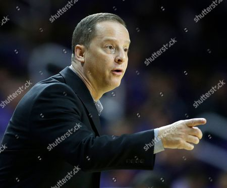 Stock Picture of Oral Roberts head coach Rodney Perry talks to his players during the first half of an NCAA college basketball game against Kansas State, in Manhattan, Kan