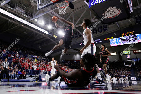 Shawn Johnsonm, Augustine Ene, Jeremy Jones. Incarnate Word guard Shawn Johnson (41) shoots in front of teammate guard Augustine Ene, on the floor, and Gonzaga forward Jeremy Jones, right, during the second half of an NCAA college basketball game against Gonzaga in Spokane, Wash., . Gonzaga won 103-68