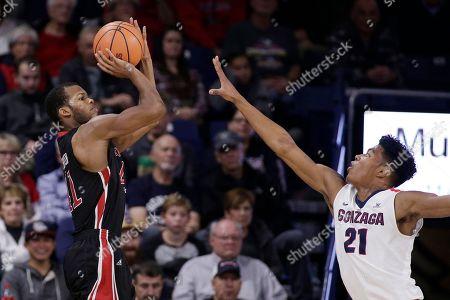 Shawn Johnson, Rui Hachimura. Incarnate Word guard Shawn Johnson, left, shoots against Gonzaga forward Rui Hachimura (21) during the second half of an NCAA college basketball game in Spokane, Wash., . Gonzaga won 103-68