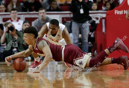 Avery Wilson, James Palmer Jr. Boston College's Avery Wilson (2) and Nebraska's James Palmer Jr., rear, scramble for the ball during the first half of an NCAA college basketball game in Lincoln, Neb