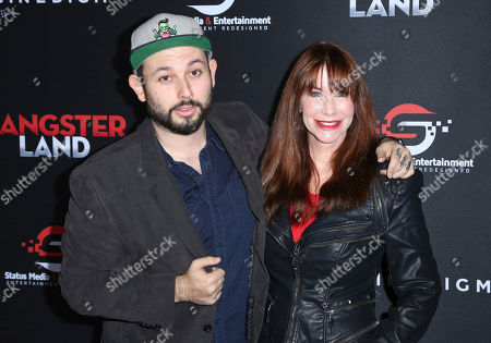 """James Cullen Bressack, Caroline Williams. James Cullen Bressack, left, and Caroline Williams arrive at the Los Angeles premiere of """"Gangster Land"""" at the Egyptian Theater on"""