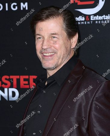 """Michael Pare arrives at the Los Angeles premiere of """"Gangster Land"""" at the Egyptian Theater on"""