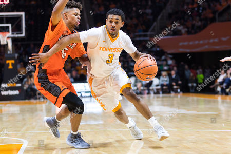 James Daniel III #3 of the Tennessee Volunteers drives to the basket against Jordan Strawberry #5 of the Mercer Bears during the NCAA basketball game between the University of Tennessee Volunteers and the Mercer University Bears at Thompson Boling Arena in Knoxville TN Tim Gangloff/CSM