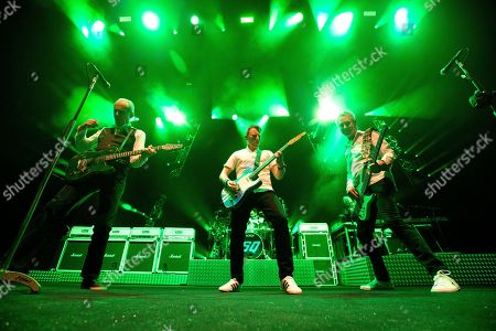 Richie Malone, Francis Rossi & John 'Rhino' Edwards of Status Quo