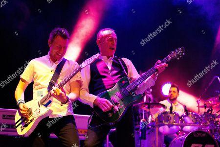 Richie Malone (Guitar & Vocals), Francis Rossi (Lead Guitar & Vocals) & Leon Cave (Drums) of Status Quo