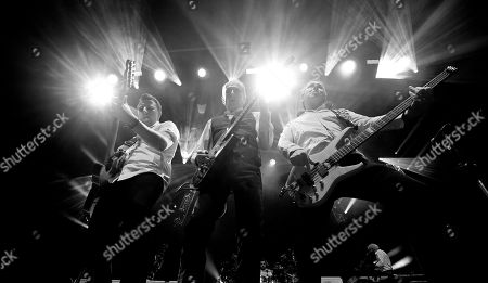 Stock Picture of Richie Malone, Francis Rossi & John 'Rhino' Edwards of Status Quo